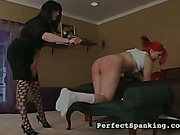 OTK spanking and whipping for kinky redhead lesbo