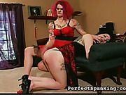 Hot domestic spanking with two mature tattooed lesbians