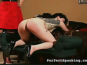 Tattooed lesbo babe spanked by her redhead mistress