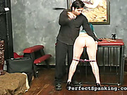 Slut with tattooed legs spanked in the dungeon