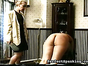 Submissive blonde and brunette spanked by mistress