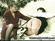 Young brunette OTK spanked by nerdy looking MILF