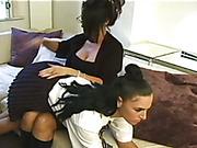 Teen babe was spanked OTK by lesbian teacher