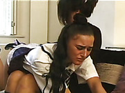 Teen babe was spanked OTK by lesbian teacher