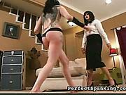 Harsh ass spanking for tattooed brunet slavegirl