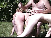 Poolside spanking scene with two wet babes