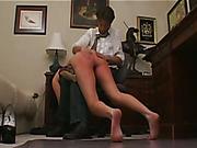 OTK spanking, hard paddling and caning for redhead