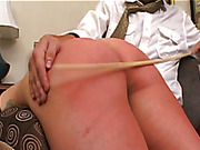 OTK spanking, hard paddling and caning for redhead