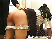Spanking of schoolgirl with a cane