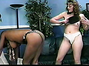Interracial ass paddling of two lesbians