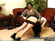 Mature lesbian bitch is spanking her victim girl
