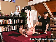 Red and bruised ass  of spanked tattoed slut