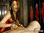 Rough spanking from Asian mistress in red latex