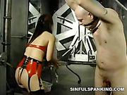 Terrible spanking for bound guy from brunette