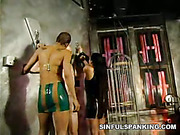 Bald male slave punished by two strict mistresses