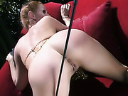 Humilation and caning of redhead's cunt and butt