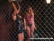 Sexy mistress in spanking scene with sub slavegirl