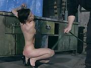 Tied to metal vise slavegirl was brutally punished