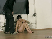 Brunette is waiting for whipping on dirty floor