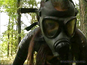 Victim in plastic wrap and gasmask punished outdoors