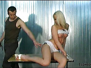 Whipping of cute blonde's cunt and ass