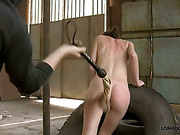 Paddling and whipping of nude in the garage