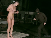 Hard spanking of slavegirl with bullwhip
