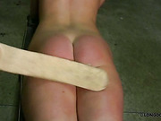 Hard paddling of poor submissive babe