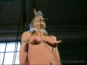 Babe in mask suffered from pinching and bondage