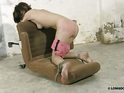 Whipping of poor babe tied to an arm-chair