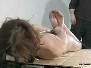 Hard whipping of hogtied bitch's ass