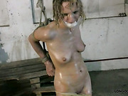 Oiled blonde was bound hard and whipped