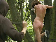 Nude bound chick got whipped in the forest