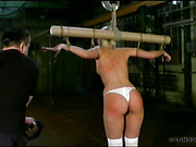 Curvy body of crucified teeny was whipped