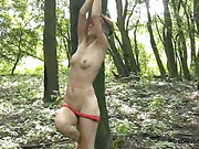 Teen bitch blindfolded and spanked in the woods