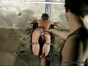 Feet and back of crying whore were caned