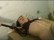 Brunette got boobs covered with wax and whipped