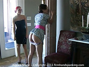 Lesbian bitch with red hair disciplines with paddling
