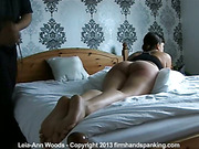 Lying on stomach brunette suffered from paddling