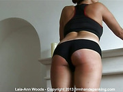 Cute brunette in black lingerie suffered from paddling