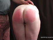 Sadistic dude paddled ass of nude redhead nymph