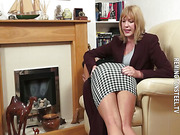 Bell has to bend over in the chair and raise her bottom for