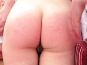 Slapping her buttocks