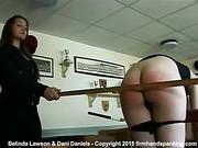 Dani Daniels takes a yard stick to Belinda Lawson's bare