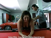 Kelsey Wilde's bottom is soundly spanked for damaging a