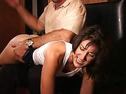 The professor spanks Tracy