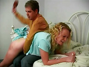 Amber Wells feels the hairbrush spank