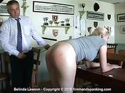 Belinda Lawson is swiftly bent over a desk