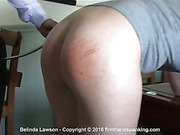 Belinda Lawson is swiftly bent over a desk