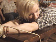 Bondaged blonde gets whipping